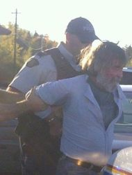 bleeding protestor - was carrying water -- now arrested